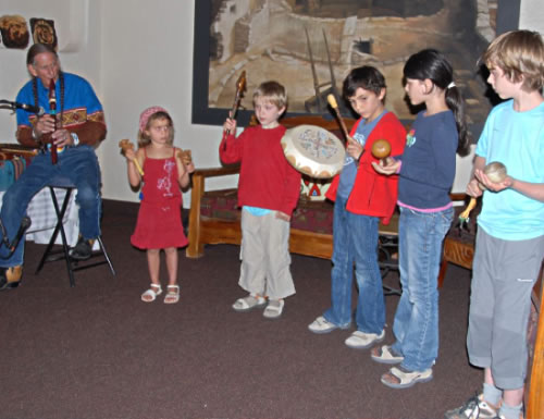 DAVID NIGHTEAGLE WITH STUDENTS AT MESA VERDE